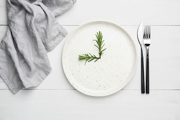 white-plate-with-rosemary